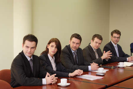 Conference, group of 5 business people sitting at the big table  Stock Photo