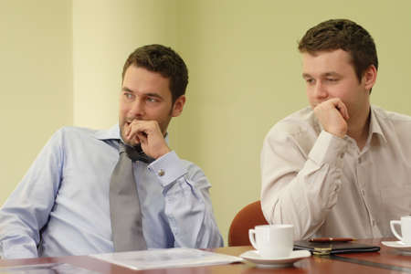 fidgety: two business people working together at the informal meeting  Stock Photo