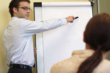 Business man making a presentation to business woman