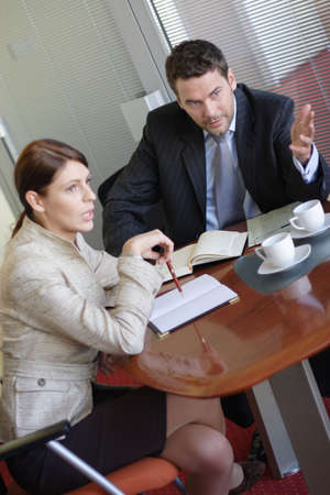 headhunting: business man and woman meeting in the office