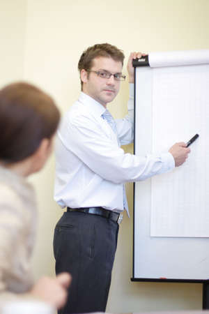 Business man making a presentation to business woman photo