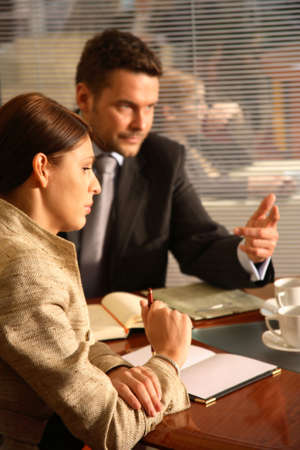 Business man and woman sitting at the desk in the office and having meeting Stock Photo - 1186667