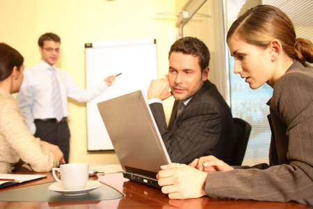 Presentation. Business people working in the office - 2 man, 2 woman Stock Photo