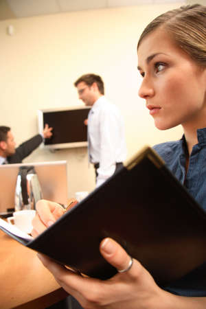 Group of three business people working at the office.woman in focus Stock Photo - 1405573