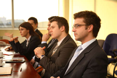 scheduling: Five business people during formal meeting