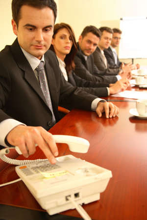 Conference call set up during a business meeting