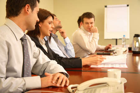 clarify: Group of  business people working together at the meeting Stock Photo