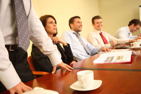 afford: Group of happy, joking business people working together at the meeting