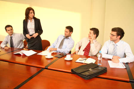 Group of business listening to their boss during informal meeting