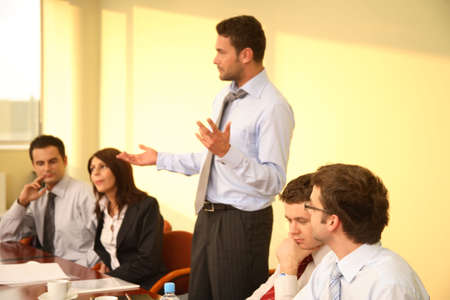 Group of business listening to their boss during informal meeting Stock Photo - 1423581
