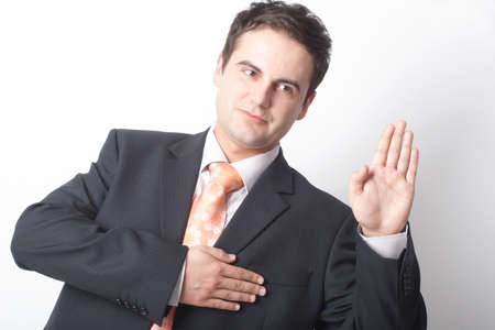 interrogation: business man telling the truth Stock Photo