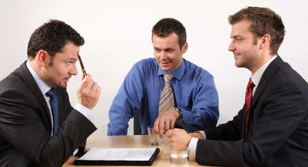 Three businessmen handling negotiations. Stock Photo - 2137734