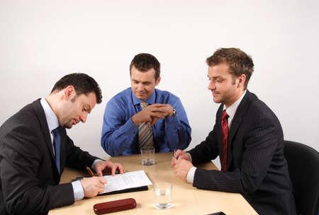 Three businessmen handling negotiations. Stock Photo - 2137731