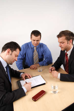 Three businessmen handling negotiations. photo