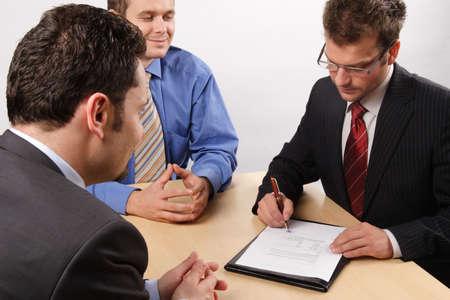 Three businessmen handling negotiations. Stock Photo - 2137741