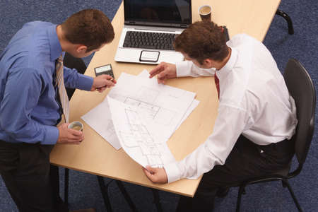 informal: Two business men working with projcet.