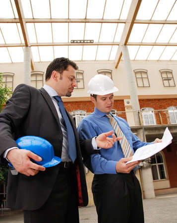 Two architects reviewing the blueprints Stock Photo