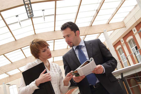 Business man and woman meeting in hall of building Stock Photo