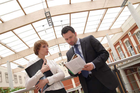 Business man and woman meeting in hall of building photo