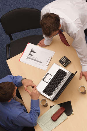 conferring: An overhead shot of two male executives in a business meeting. Stock Photo