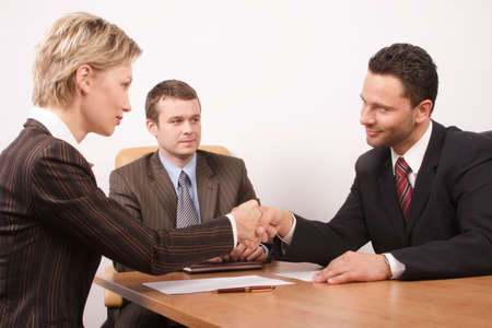 professionalism: Negotiation over,contract signed,man and woman handshake Stock Photo