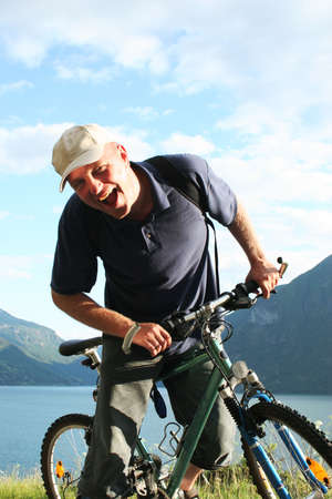 Shouting man with bike in the mountains Stock Photo - 3175653