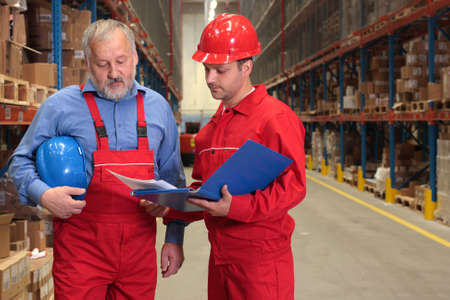 two workers in uniforms in warehouse Stock Photo - 3232349