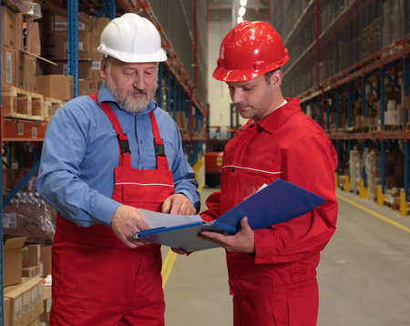 two workers in uniforms in warehouse Stock Photo - 3232336
