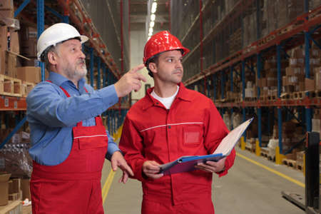 two workers in uniforms in warehouse Stock Photo - 3232341