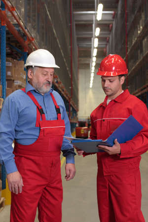 two workers in uniforms in warehouse Stock Photo - 3232343