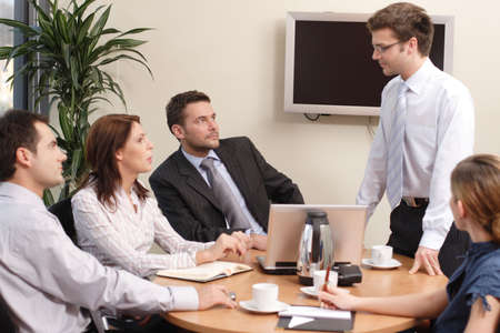 reporting: business group  coaching Stock Photo