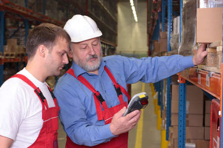 storeroom: A view of a senior engineer training a newly hired employee. Stock Photo