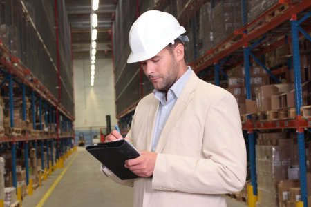 inspection: supervisor counting stocks Stock Photo