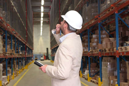 inspection: worker counting stocks in warehouse Stock Photo