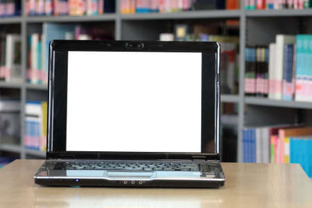 Laptop at the desk with space for copy at the screen photo
