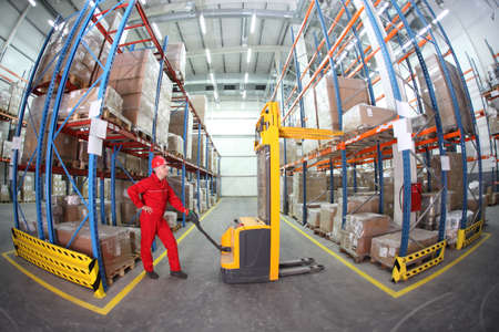 manual forklift operator at work in warehouse photo
