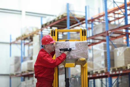 bar code reader: worker with bar code reader working in warehouse Stock Photo