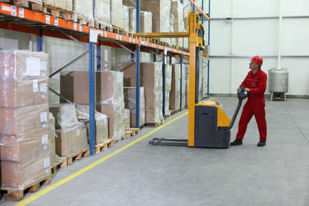 manual forklift operator at work in warehouse Stock Photo - 7250504