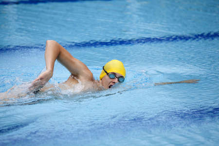Swimmer in yellow cup breathing during front crawl photo