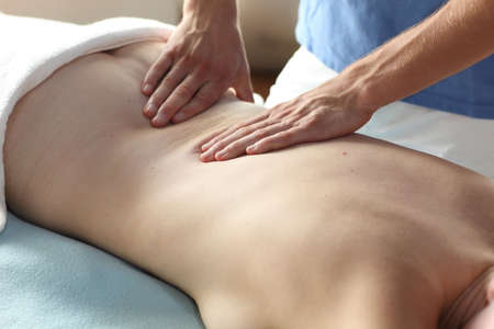 back rub: female receiving back massage - close up Stock Photo