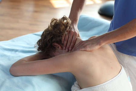 back rub: Female receiving neck massage,close up Stock Photo