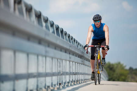 fit cyclist riding on race bike Stock Photo - 9801903