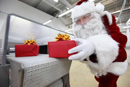 duty belt: santa claus & christmas gift machine Stock Photo