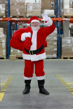commercialization: Santa Claus ready for Christmas,waving Stock Photo