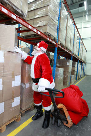 commercialization:  Santa claus looking for presents in storehouse