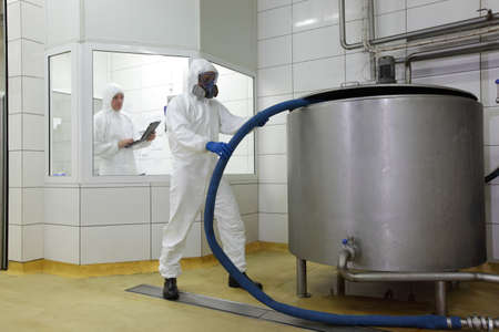 chemical industry:  two professionals working in  industrial environment