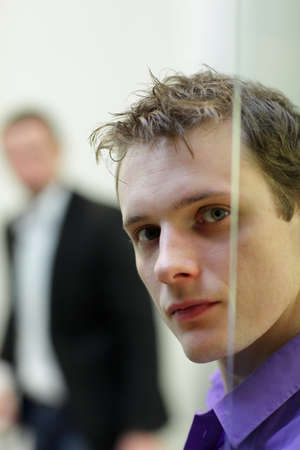 window pane: Pane,young, white man s face portrait, another man in background