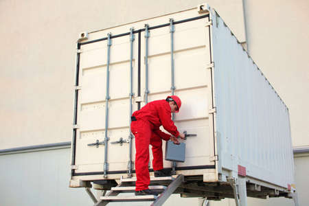 technician with tool case opening movable workshop in container photo