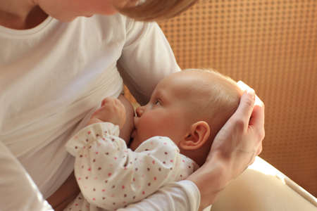 breastfeed:  mother breastfeeding baby
