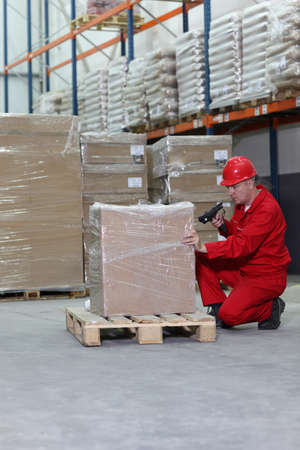worker with bar code reader working in warehouse photo